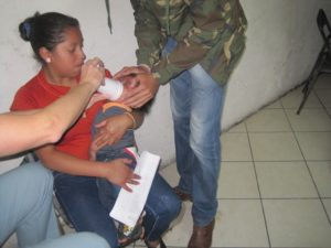 Breathing treatment for child in respiratory distress.